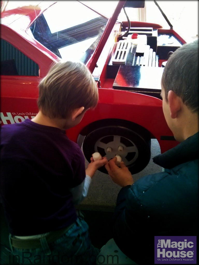 Changing a tire at The Magic House